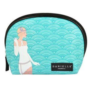 Este original neceser de viaje que también hace de bolso de mano ha sido creado la firma británica Danielle tiene un diseño muy divertido de una mujer vestida de charleston.